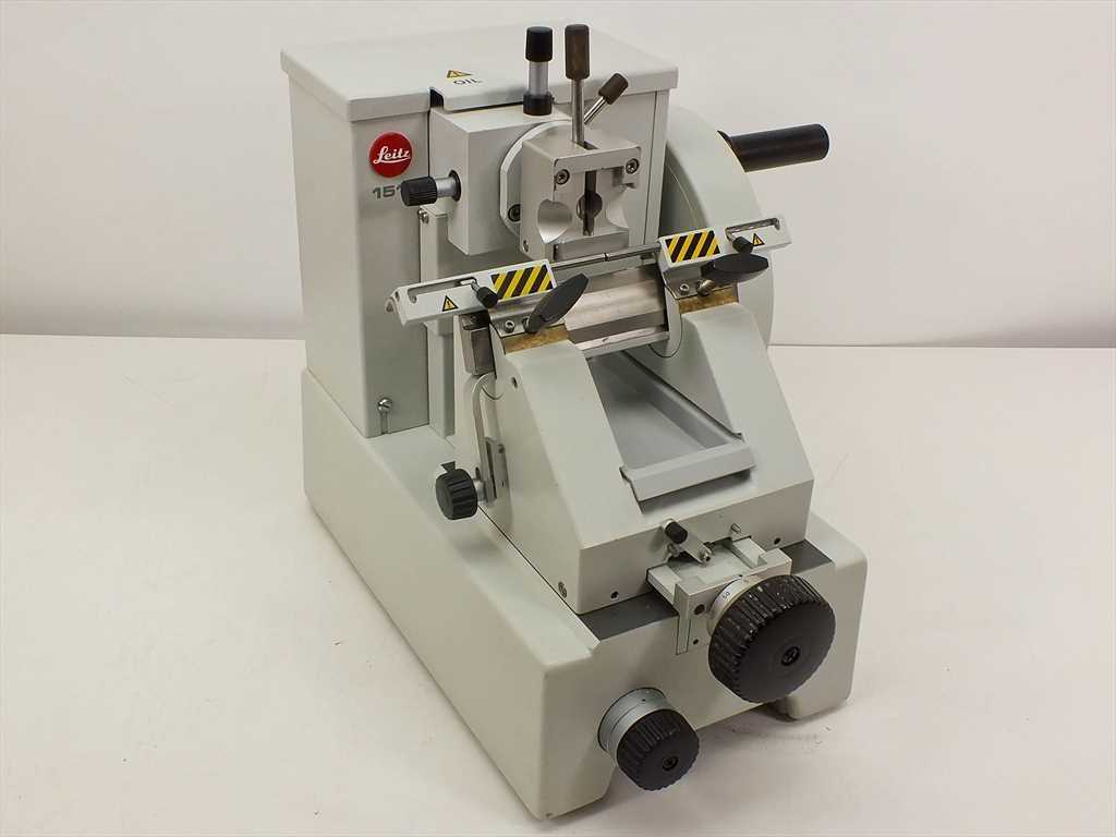 Microtome with finger guards engaged and highlighted.