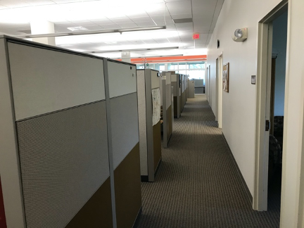 Office showing high cubicle walls