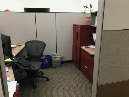Tall barriers provide protection for a single person in a cubicle.